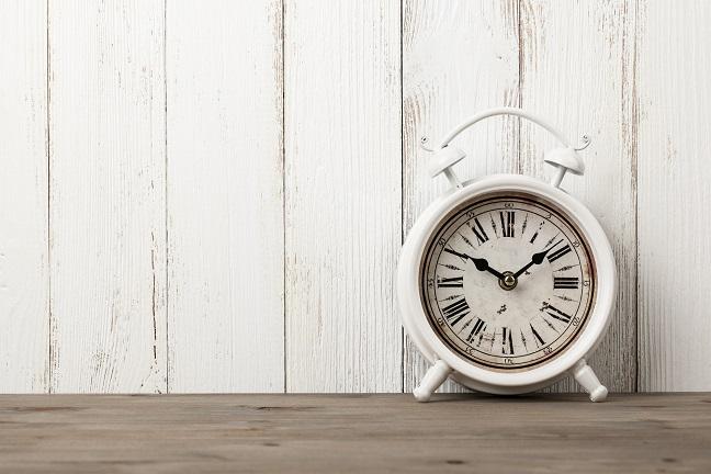 vintage-alarm-clock-on-wooden-table-PE5R94H