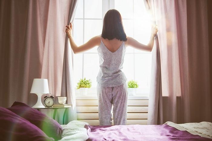 woman-enjoying-sunny-morning-PVCX84D