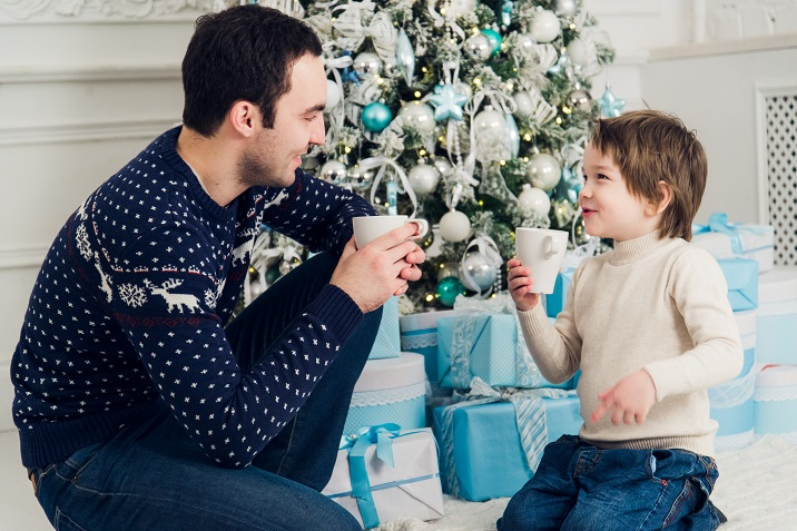 happy-dad-and-son-with-cups-of-tea-talking-near-PHSEJY7