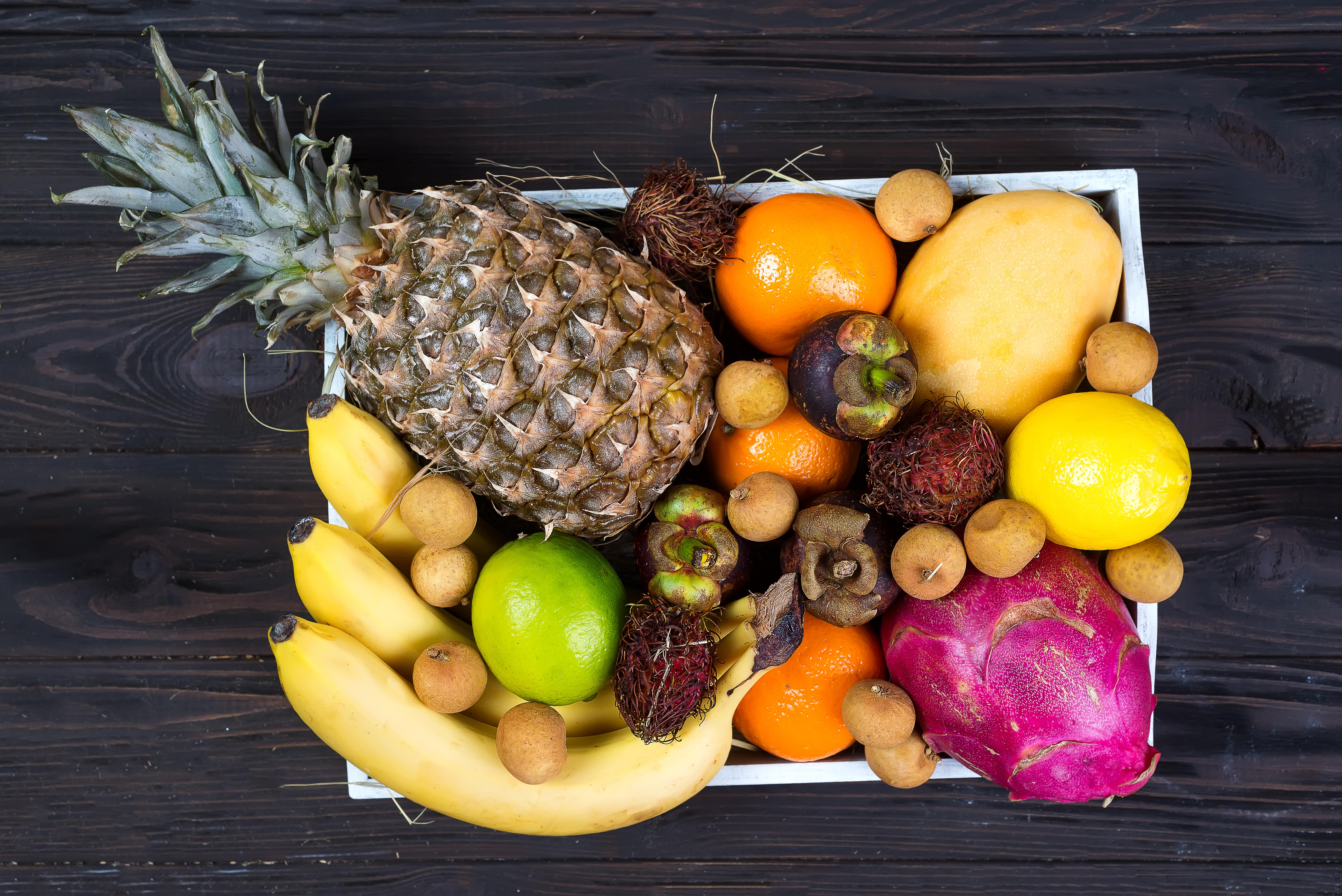 fresh-exotic-fruits-in-a-wooden-box-top-view-with--L3576Z2-min