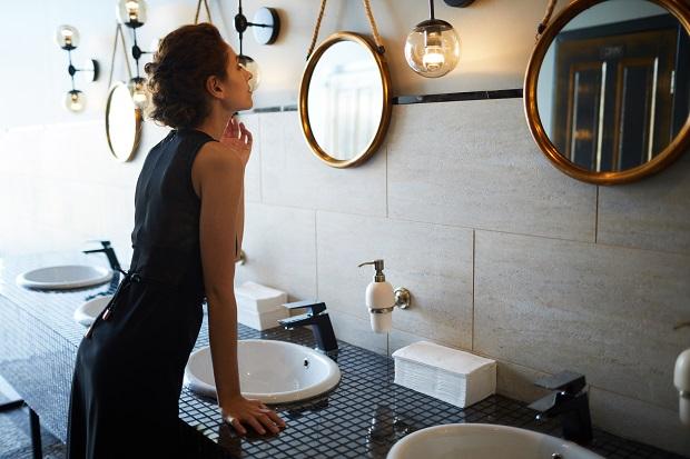 woman-in-bathroom-MRLE78J