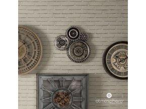 Nástěnné hodiny složené ze čtyř ozubených kol, vyrobené z polystyrenu, ABS a skla