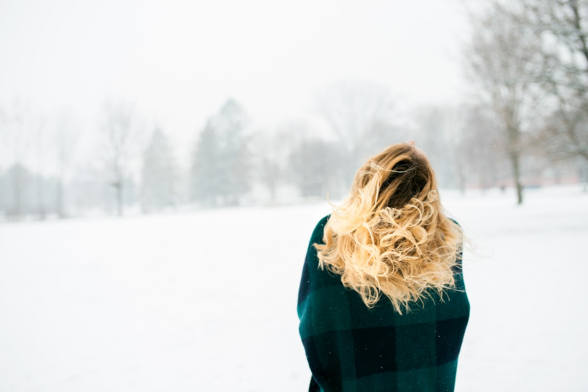 blond-woman-throwing-her-hair-winter-nature-back-v-PXC8ZDL