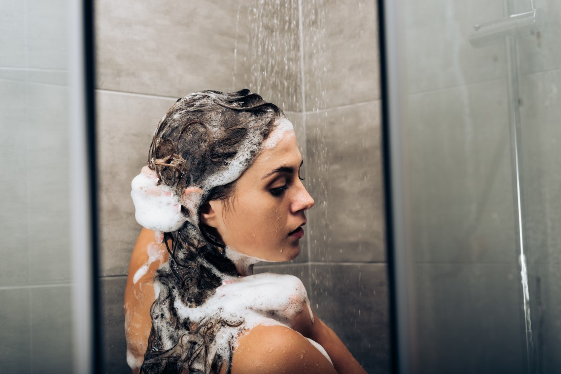 girl-washing-hair-with-shampoo-in-a-glass-shower-c-YHV8BA9