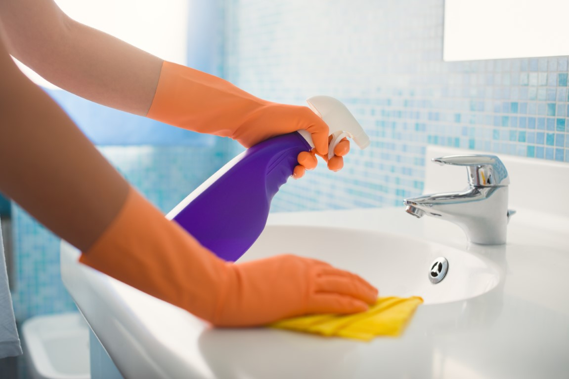 woman-doing-chores-cleaning-bathroom-at-home-P54NYLL