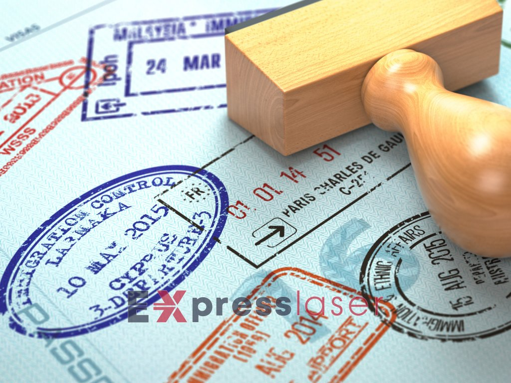 passport with visa stamps travel or turism concept V7ZFKQ3