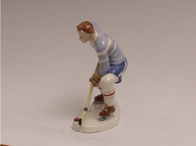 Porcelánová soška hokejisty