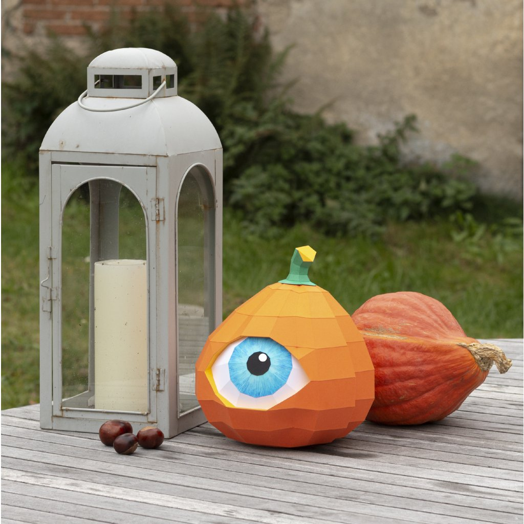 eyed pumpkin on table with lamp