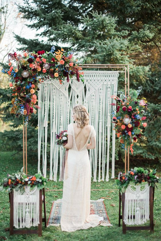 12-a-macrame-wedding-backdrop-with-bright-orange-burgunyd-peachy-pink-and-blue-flowers-plus-greenery