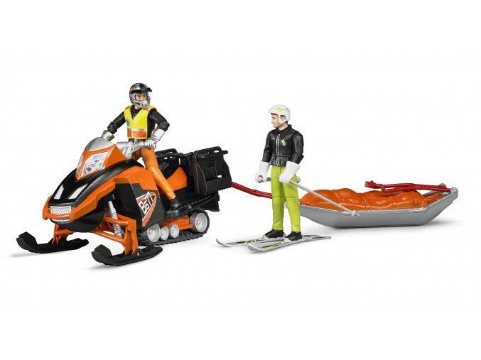 Bruder 63100 Sněžný skůtr a Akia záchrannými sáněmi s lyžařem