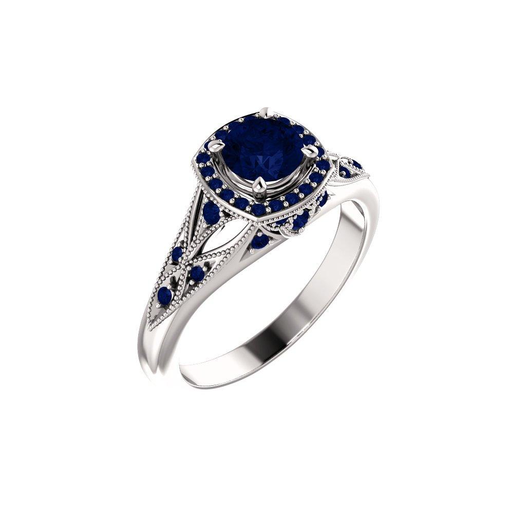 123832 B M prsteň z bieleho zlata s modrými kamienkami