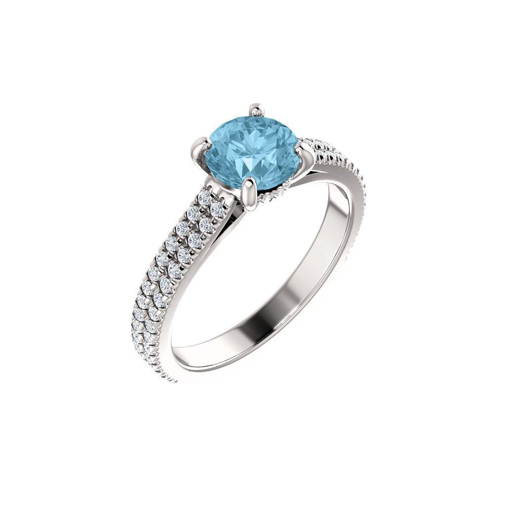 123972 B BX prsteň z bieleho zlata s belasým očkom