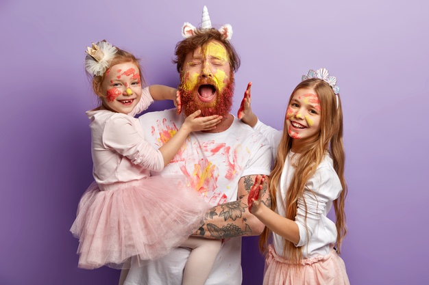 overloaded-fatigue-single-father-with-ginger-beard-cries-desperately-has-fun-with-two-female-kids-use-colourful-paints-have-happy-expressions-stand-purple-wall-happy-fathers-day-concept_273609-26130