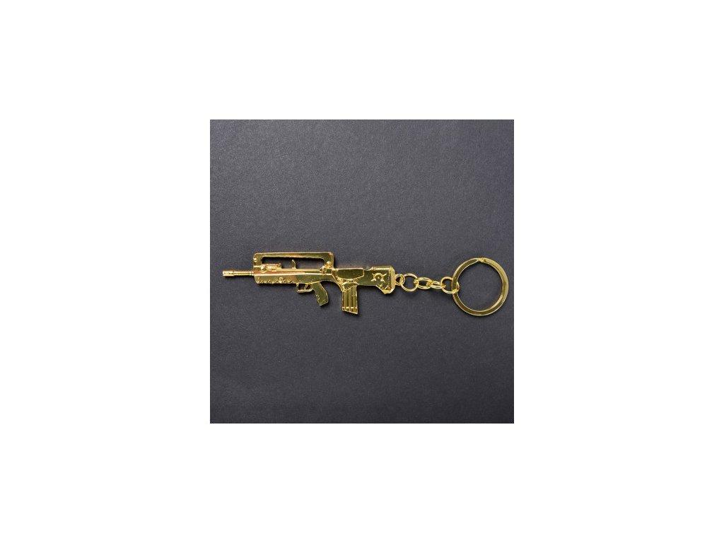 Counter-Strike Fadecase Klíčenka - Famas - 18K Gold
