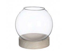 skleněná koule v dřevěném podstavci
