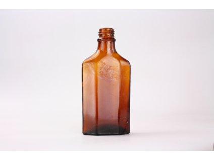 Stará skleněná lahev hnědé sklo