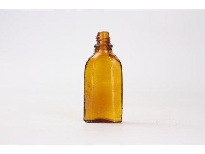 Stará skleněná lahvička hnědé sklo