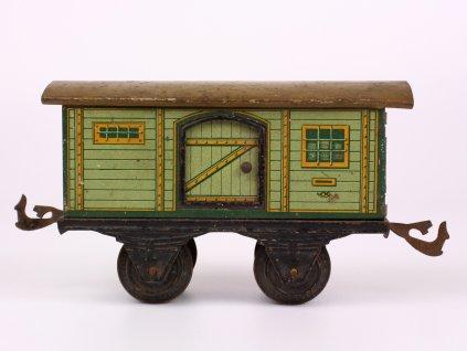 Starožitná hračka plechový vagón k lokomotivě zelený