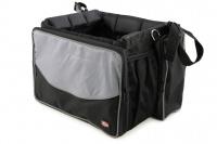 Přepravní box-taška na psa k připevnění na řídítka. Vyztužený rám, měkké polstrování, reflexní prvky, kapsy na zip, možnost přenášení přes rameno. Nosnost 7 kg, rozměry 41 × 26 × 26 cm. (3)