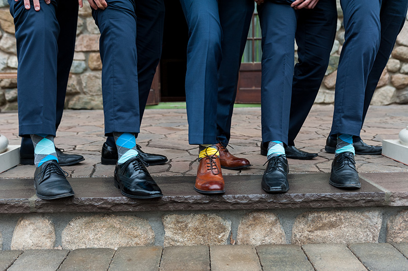 groomsmen-navy-suits-argyle-socks-black-and-brown-wedding-shoes