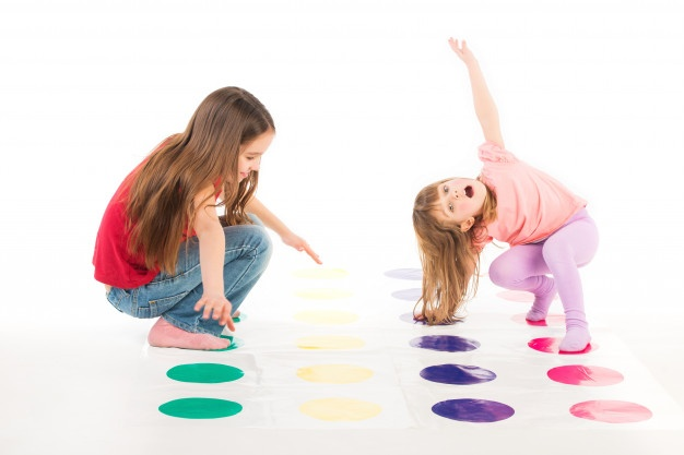 two-happy-girls-play-twister-game_212944-293
