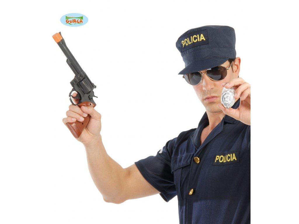 Revolver s policejním odznakem