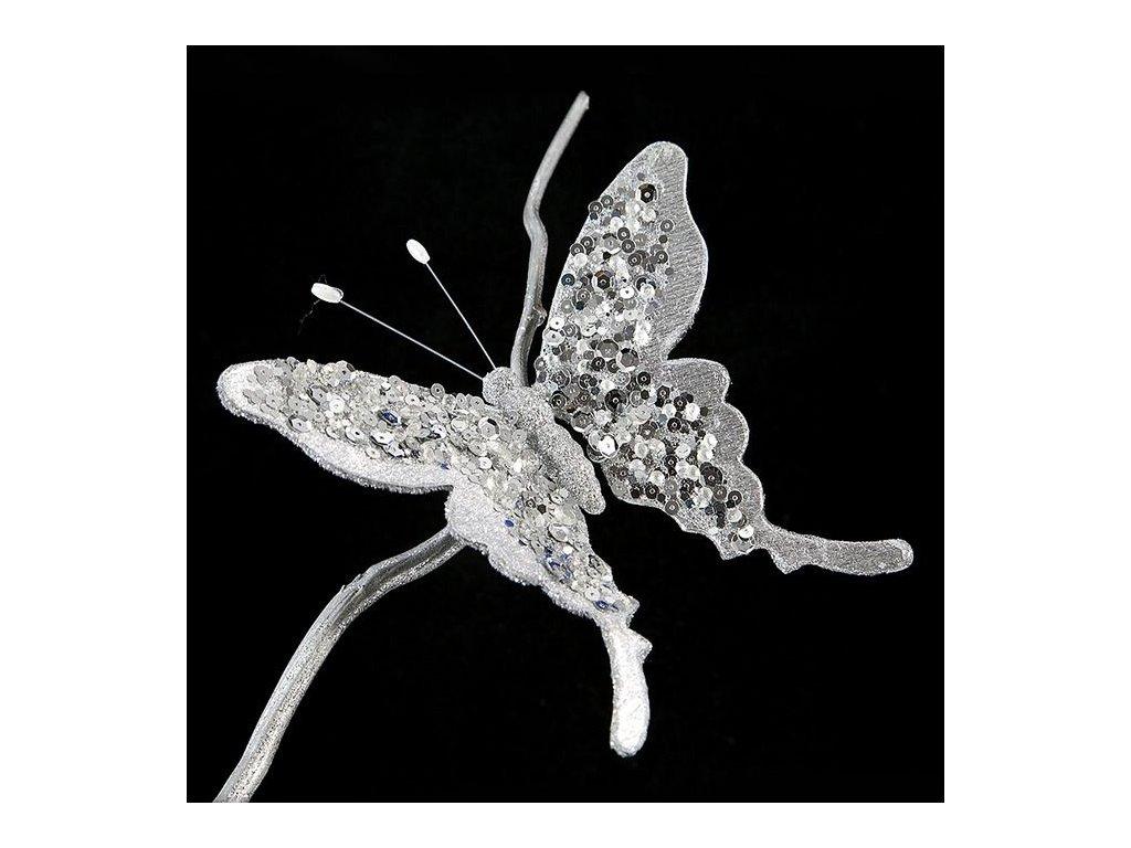 Šedý motýl s flitry na kovovém klipu
