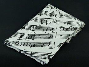 bílá utěrka s partiturou