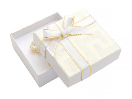 bila-papirova-krabicka-s-masli-se-zlatym-okrajem-na-malou-sadu