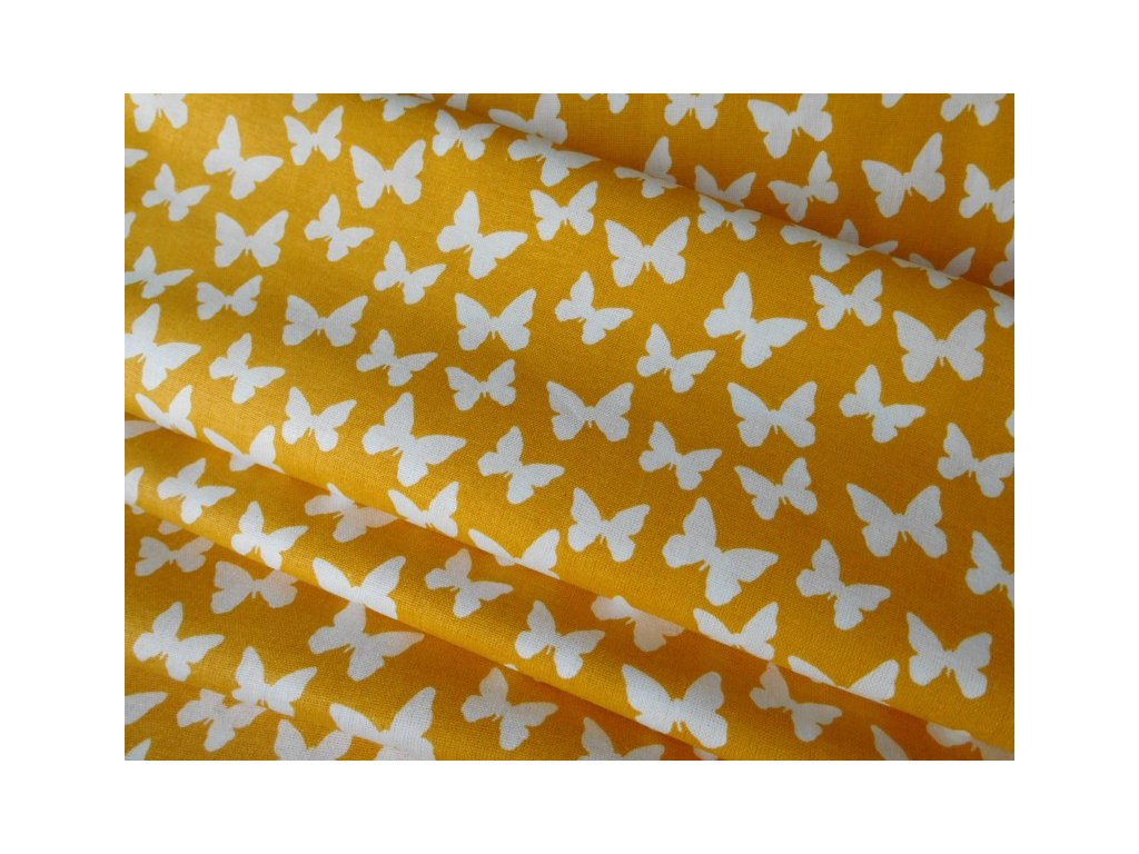 Bílí motýlci -žlutooranžový podklad-látka-metráž