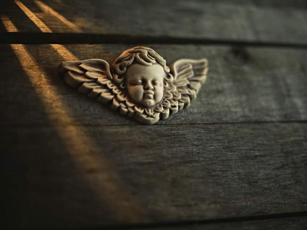 Reliéfní andílek