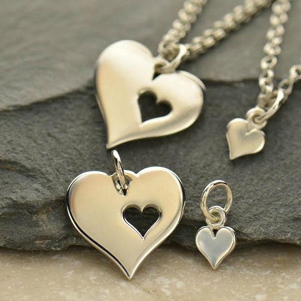 Sada stříbrných přívěsků - velké srdce s malým srdíčkem