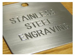 magnified image of engraving in stainless steel n144