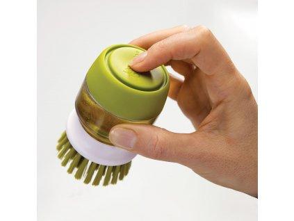 Szczotka z dozownikiem środka czyszczącego zielona Palm Scrub™ Joseph Joseph