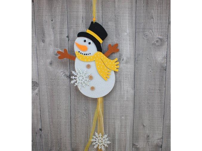 Sněhulák letící žlutý