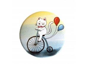 kočička na kole placka