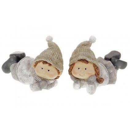 Chlapec nebo děvče, ležící s čepicí na hlavě, zimní dekorace z polyresinu. Mix 2druhů. Cena za 1ks.