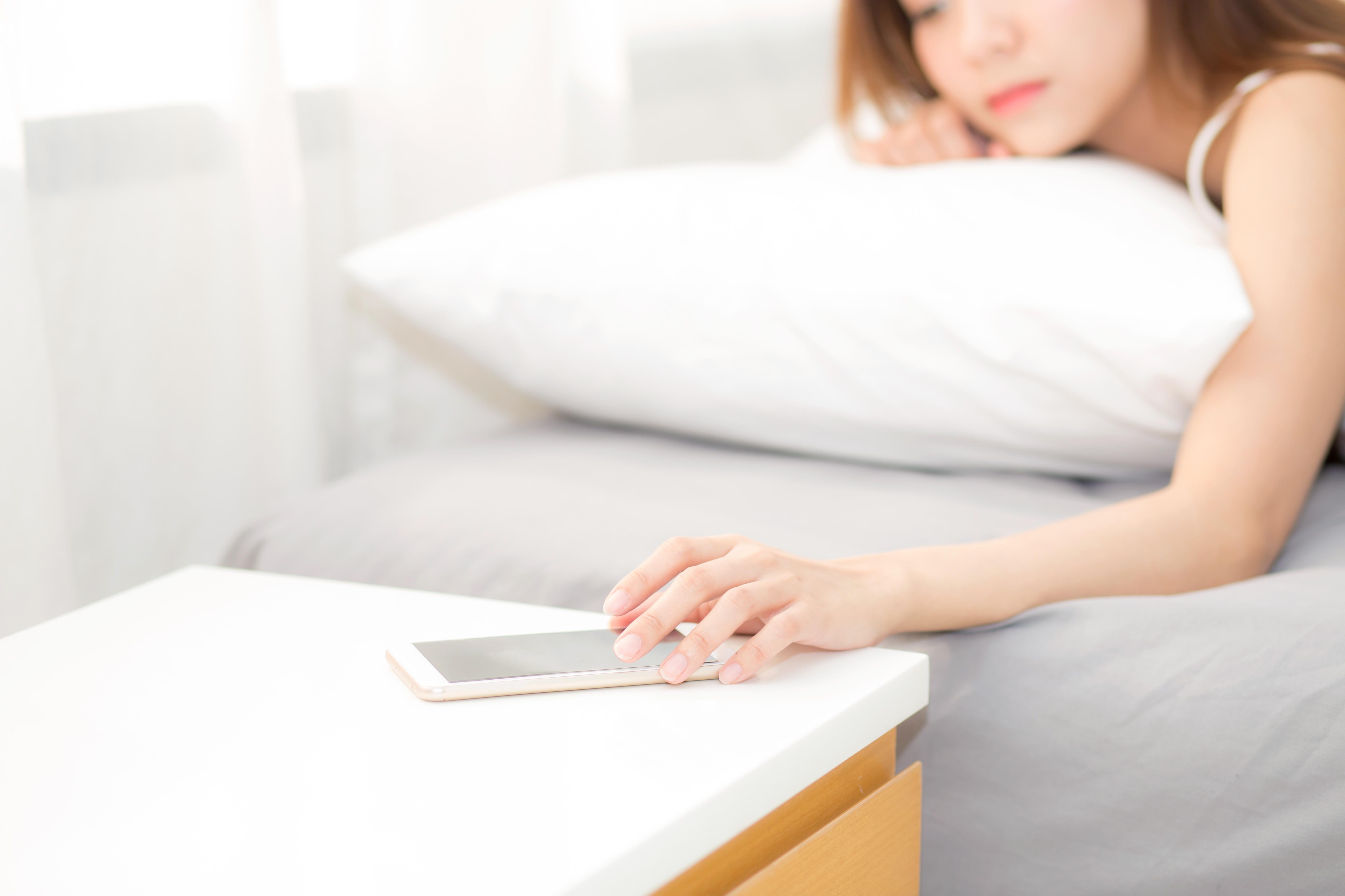 bigstock-Hand-Of-Woman-Turn-Off-Alarm-O-227764183