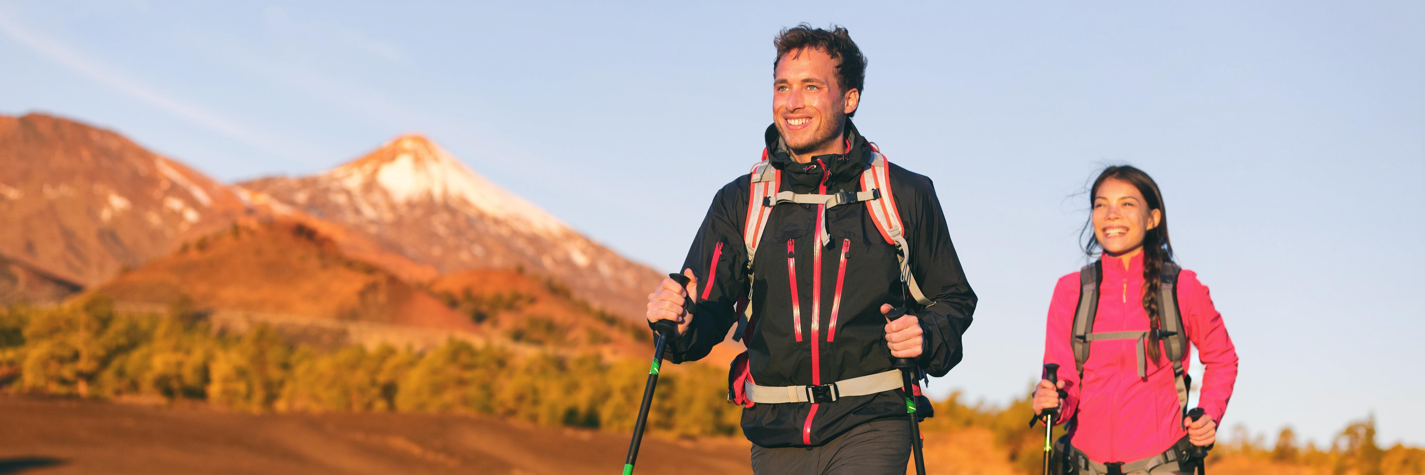 bigstock-Hiking-hikers-couple-trekking--229120057