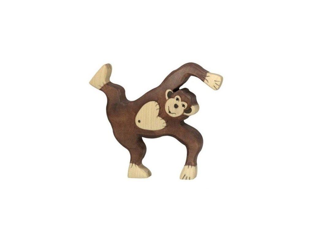 Šimpanz hrající si – dřevěné zvířátko