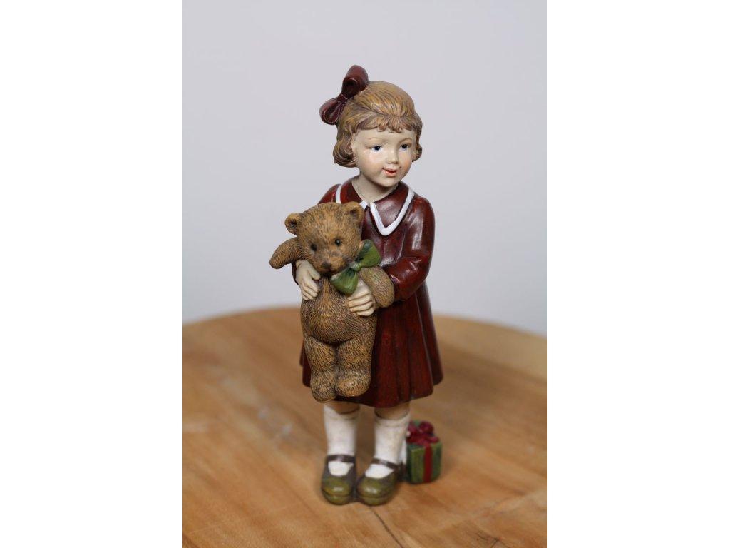 figurka stojící holčička