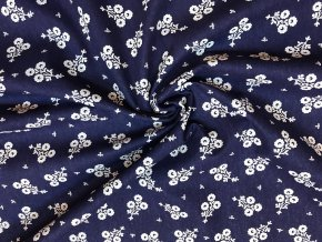 bavlnene platno svazek bilych folklornich kvetu na modre
