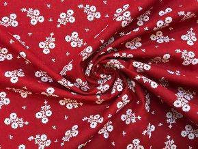 bavlnene platno svazek bilych folklornich kvetu na cervene