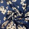bavlneny uplet kvety velke bile na modre uvod