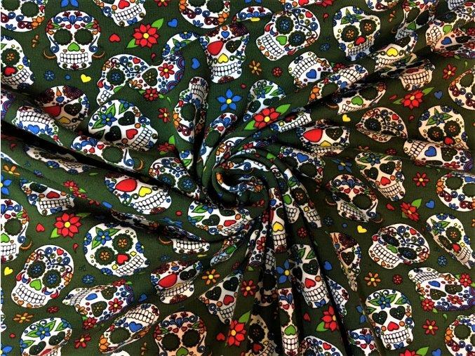 Bavlnený úplet mexické lebky na zelenej