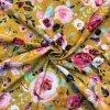 Bio bavlnený úplet kvety na horčicovej GOTS