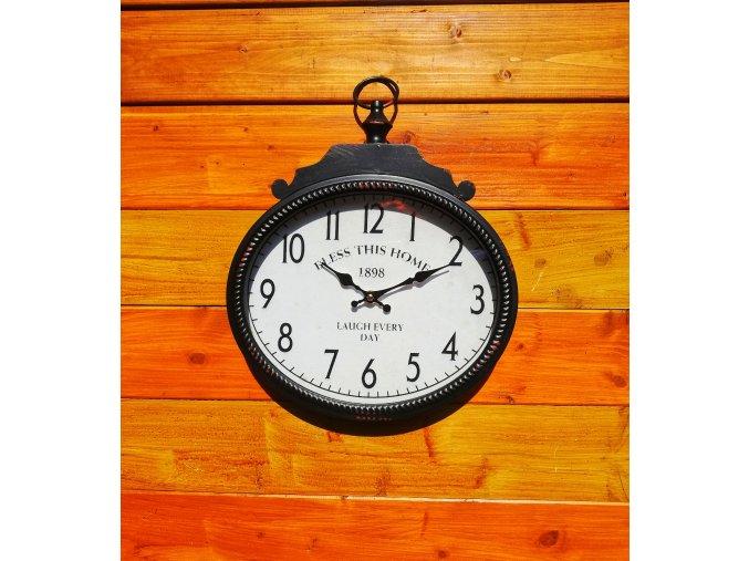 Oválné kovové hodiny