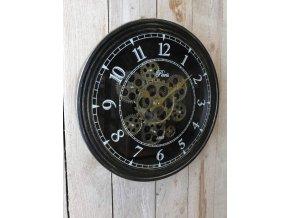 Černé hodiny se zlatým rotačním mechanismem