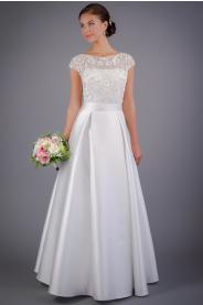 Svatební šaty se skládanou sukní a vyšívaným živůtkem