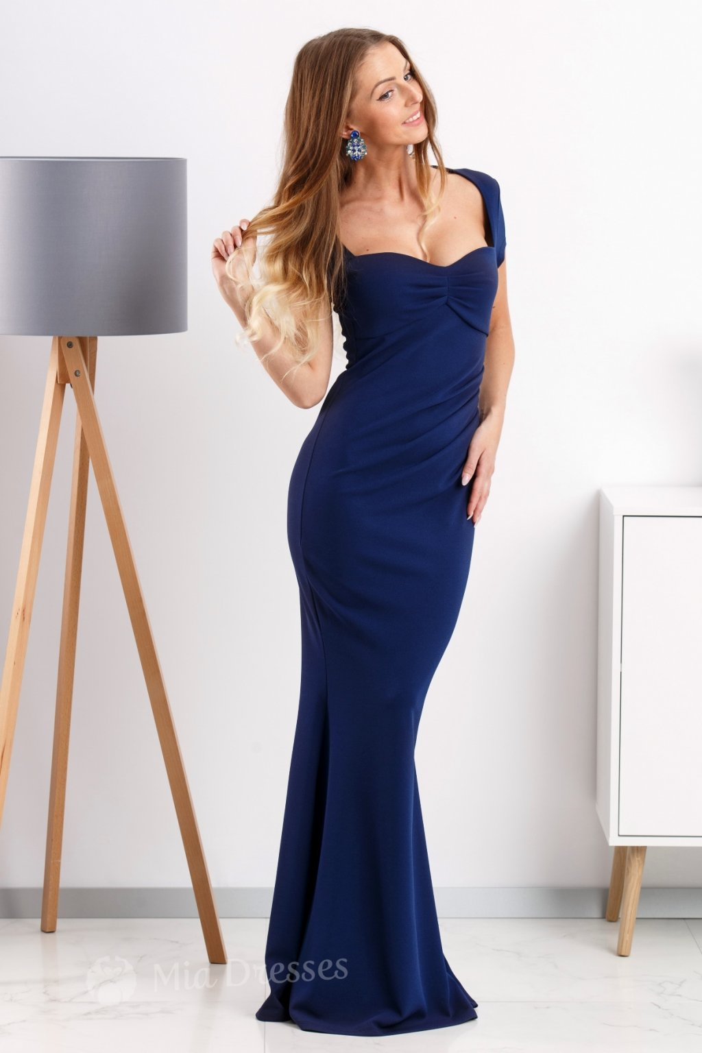 Dark blue formal dress with cut neckline